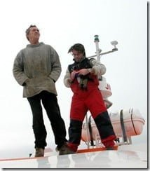 Whale watching operator Colin Barnes (left), and Pádraig Whooley of the IWDG scan for whale activity from the roof of the boat.