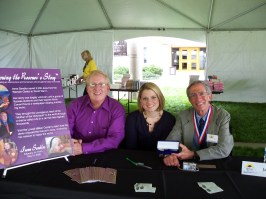 Educator, Norm Conard, Irena Sendler Project member, Jaime Walker Berndt, and author Jack Mayer, sign books.