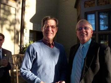 Governor of Kansas, Sam Brownback, visits with educator, Norm Conard, at the Kansas Book Festival Reception.