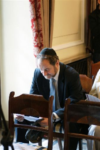 Piotr Kadlcik, Chairman of Jewish Community of Warsaw reading the program.