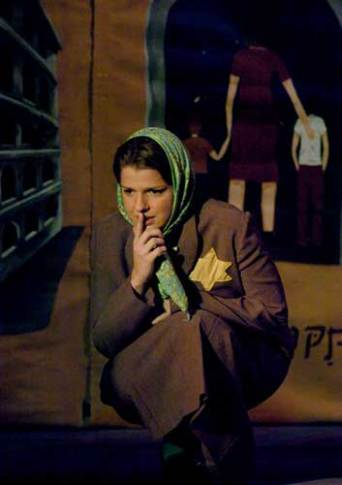 Jaime Walker, newer member of the cast, playing the Jewish mother, Mrs. Rosner. In this scene, Jaime is talking to her children.