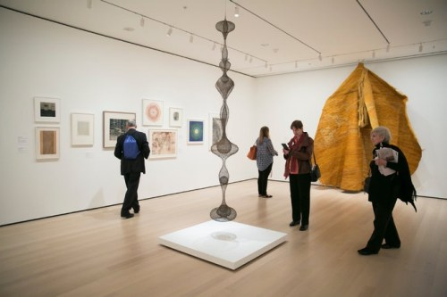 """Ruth Asawa's """"Untitled"""" (circa 1955), foreground center, and Magdalena Abakanowicz's """"Yellow Abakan"""" (1967-68), right.                                                                            Nicole Craine for The New York Times"""