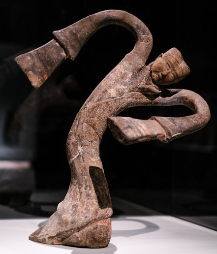 """Female Dancer,"" a vogueing earthenware dancer from the Han dynasty.  Photo: Jake Naughton for The New York Times"