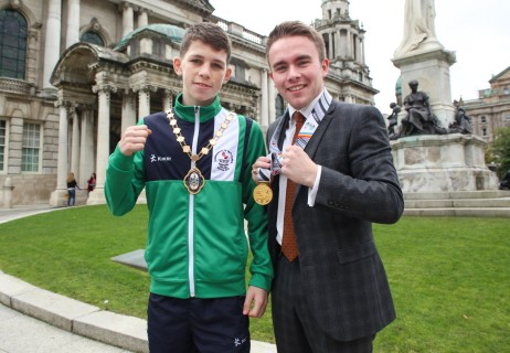 Ireland's Commonwealth Youth team and coaches hosted by Belfast Lord Mayor Arder Carson at Belfast City Hall Pictured: Monaghan Boxer Stephen McKenna and Belfast Deputy Lord Mayor swap golds at Belfast City Hall.  Picture - Chris Scott / AMMG