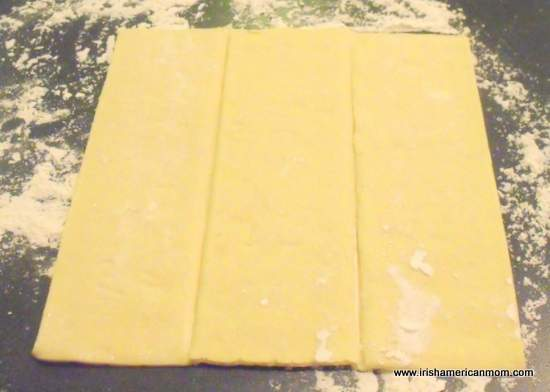 Puff pastry sheet on floured surface