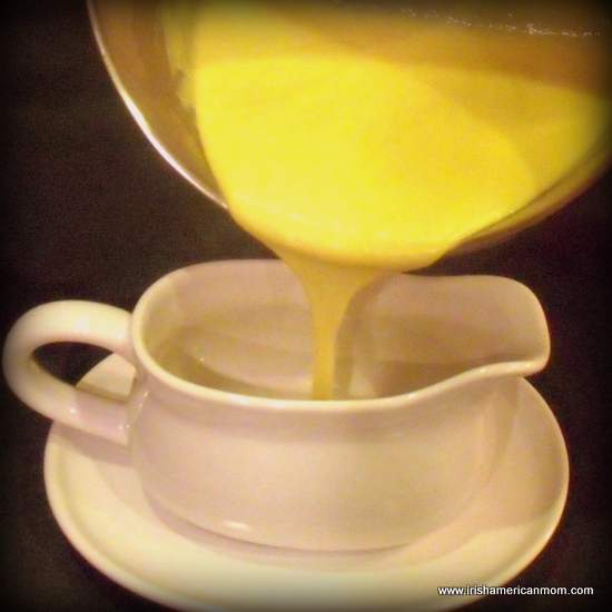 Egg custard sauce pouring into a sauce boat