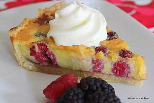 Slice Of Berry Almond Tart with Cream