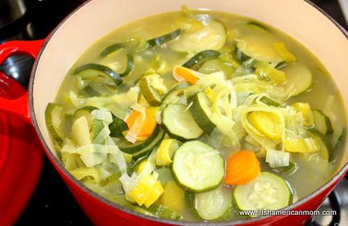 Tender vegetables in stock before pureeing soup