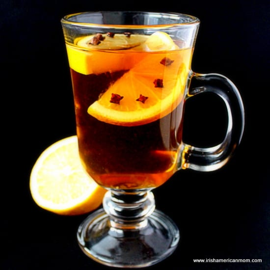 Lemon infused hot whiskey with cloves
