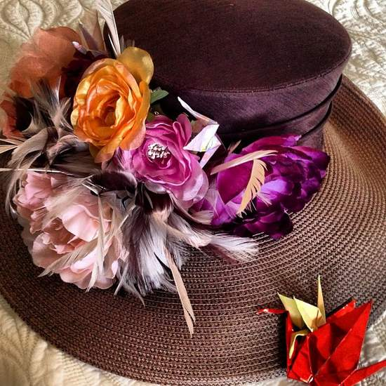 Feathered purple derby hat