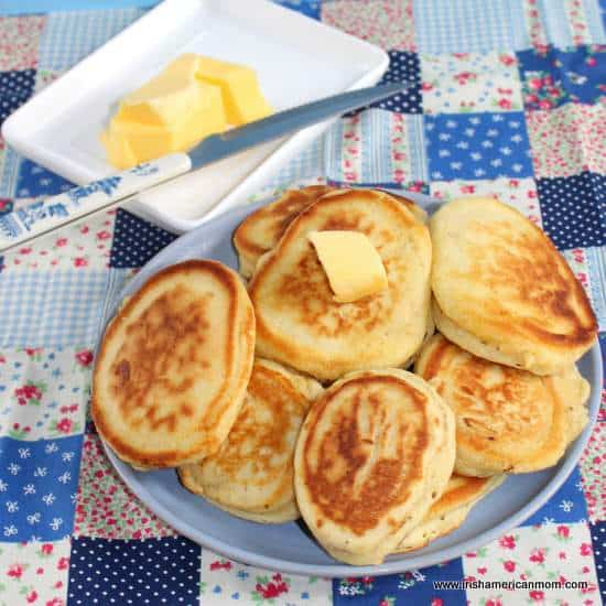 A plate of buttermilk pancakes with butter