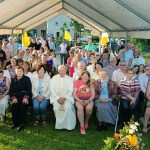 KERRY: The annual Mass for Manor Village residents was recently  celebrated by Canon James Linnane, sitting centre of seat. The O'Shea brothers supplied the music, and refreshments were served by  the community. Photo: John  Cleary
