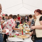 People lining up for food in the Polish tent.