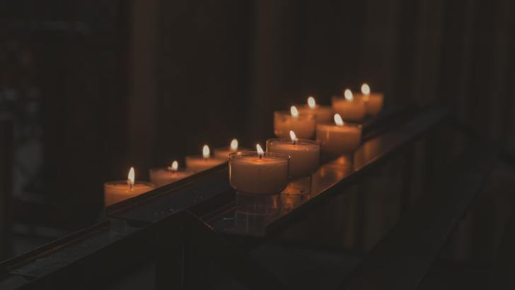 Why do we light candles for the dead?