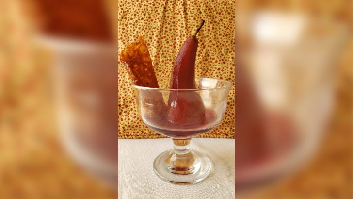 Juicy poached pears with brandy snaps