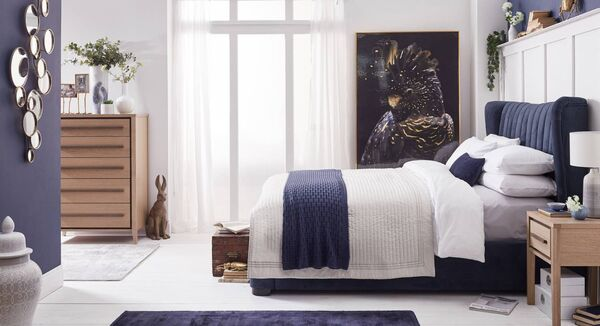 Here's how inviting a bedroom can be with an upholstered headboard on the Amelia bed frame (from €799), the eclectic Bubble mirror providing form and function (€139) and the fun Parrot picture (€219). From Caseys.