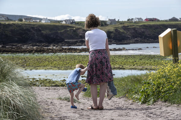 Sharon Ni Chonchuir and son Milo pictured on a West Kerry Beach. Picture: Domnick Walsh