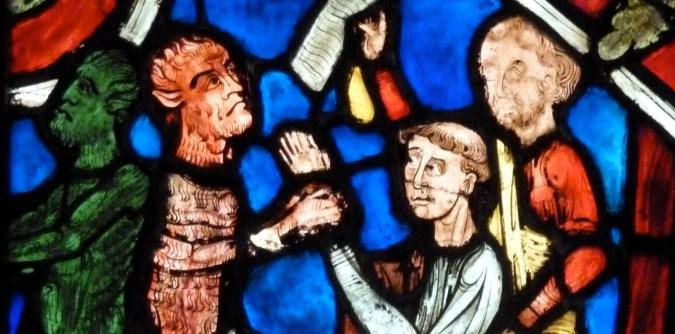 Stained glass depicting monks battling demons