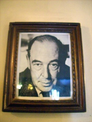 A photograph of C. S. Lewis hanging in The Eagle and Child pub in Oxford