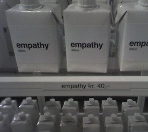 "Cartons labelled ""empathy"" stacked on shelves."