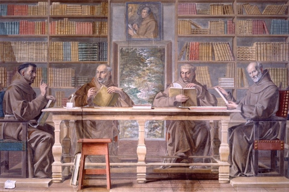 Fresco depicting four Franciscan friars seated around a table with a portrait of Duns Scotus looking on.