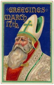 St Patricks Day card featuring St Patrick with a white beard and wearing a bishops mitre. The card reads: Greetings March 17th