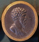 Gem bearing profile of Marcus Aurelius, who is bearded with short curly hair