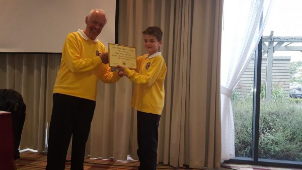 Daniel receiving his Level 1 Paw Point Certificate presented by Chairma Brian O'Sullivan