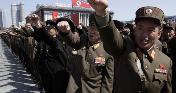 North Korean army officers punch the air in a sign of loyalty at a rally in Kim Il Sung Square in central Pyongyang, North Korea. Photograph: Jon Chol Jin/AP
