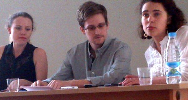 Edward Snowden (centre) with Sarah Harrison (left) of WikiLeaks. Photograph: Tanya Lokshina/Human Rights Watch