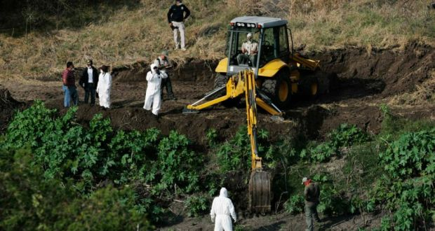 Forensic technicians search for human remains in a mass grave on the banks of the Lerma river in La Barca. Photograph: Alejandro Acosta/Reuters