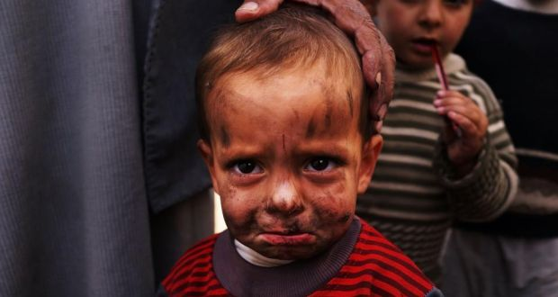 """A displaced Syrian child in a makeshift camp for refugees only miles from the Syrian border in Majdal Anjar, Lebanon. """"If we do not act quickly, a generation of innocents will become lasting casualties of an appalling war,"""" the UNHCR report said. Photograph: Spencer Platt/Getty Images"""