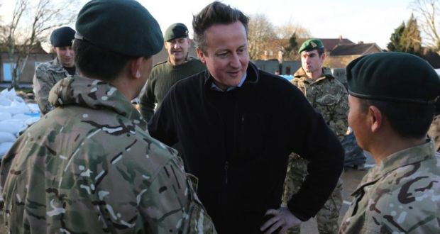 British prime minister David Cameron meets soldiers from the  Royal Gurkha Rifles, at a military command centre in Chertsey, southern England. Photograph: Paul Hackett/Reuters