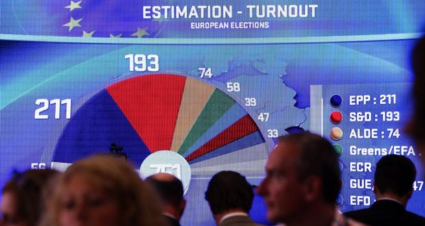 A projection shows an estimation of seats in the European parliament on giant screen at EU parliament during elections evening in Brussels this evening.  Photograph: EPA