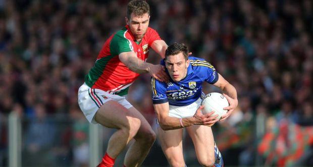 Kerry's David Moran and Séamus O'Shea of Mayo will renew acquaintances on Sunday. Photograph: Cathal Noonan/Inpho