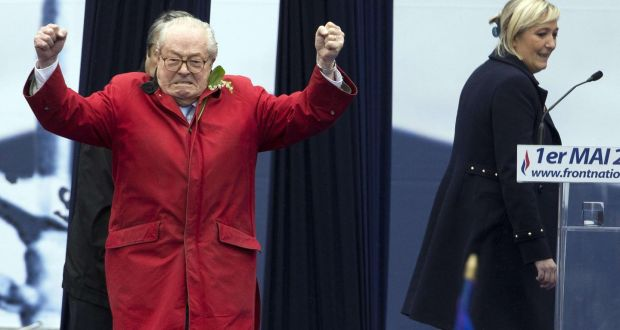 France's far-right Front National  founder and honorary president Jean-Marie Le Pen gesturing on stage with his daughter, Marine,  with whom he is at logger heads. Photograph: Kenzo Tribouillard/AFP/Getty