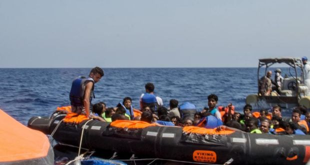 Surviving migrants are brought aboard Irish and Italian Navy life-boats in the area where their wooden vessel capsized and sank off the coast of Libya on Wednesday. Photograph: Reuters