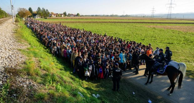 Police escort migrants and asylum seekers as they walk to a refugee centre after crossing the Croatian-Slovenian border near Rigonce on October 24th. Photograph: Jure Makovec/AFP/Getty Images