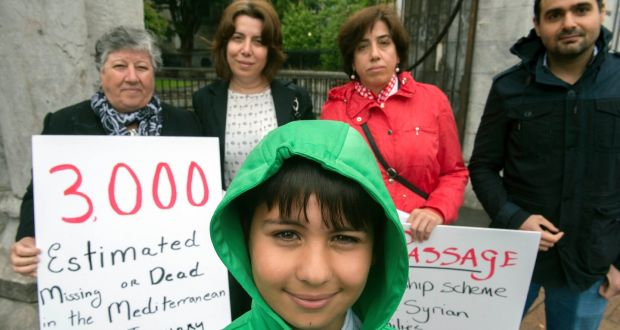Immigrant group Nasc hold a silent solidarity walk through Cork city on Sunday to mark World Refugee Day: Pictured are Nisreen Youssef (red) with her son Carlos, mother Dalal, sister Rather and Amjad Shad. Photograph: Michael MacSweeney/Provision