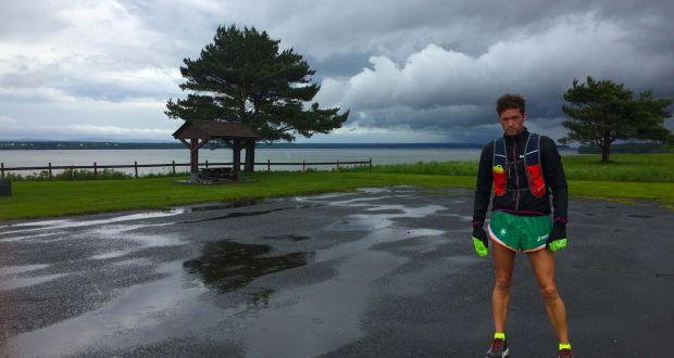 The second day's run begins under dark skies for Michael Collins. Photograph: Anne Petersen