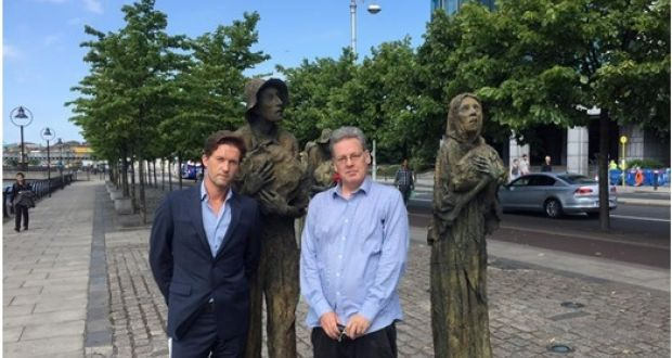 Michael Collins and Jason King beside Rowan Gillespie's Famine memorial in Dublin