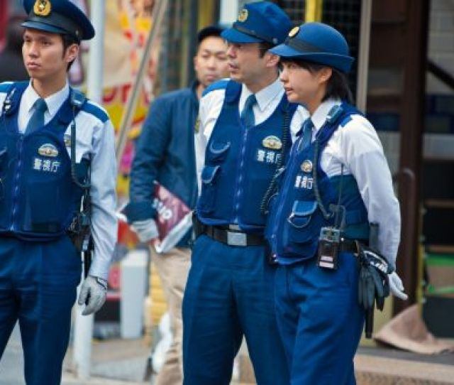 Japanese Police Officers Standing On A Tokyo Street Photograph Istock