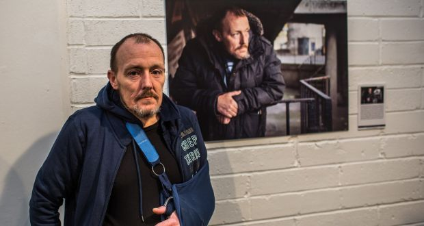 William Power stands in front of his portrait which was taken as part of the 'People Like Us' exhibition which opened on Thursday. Photograph: James Forde