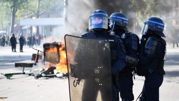 Anti-riot police hold a position during clashes in Paris, as thousands of yellow-vest protesters took to the streets in the 23rd week of anti-government marches. Photograph: Anne-Christine Poujoulat/AFP/Getty Images