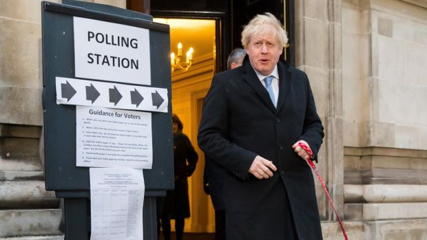 UK Prime Minster Boris Johnson leaves the polling station after casting his vote. Photograph: Vickie Flores/EPA.