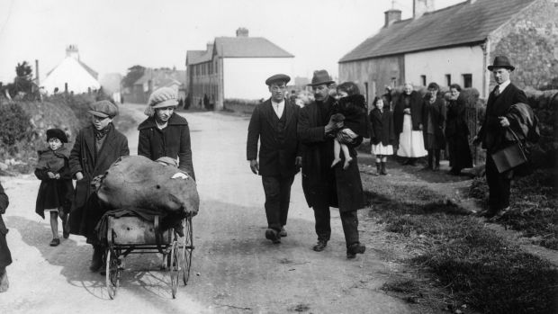 September 1920: Refugees leaving Balbriggan, County Dublin, the scene of violent reprisals by Black and Tans following the murder of Head Constable Burke of the Royal Irish Constabulary. Photograph: Topical Press Agency/Getty Images