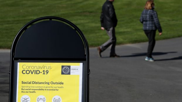 A sign with guidelines on social distancing when outdoors in the Botanic Gardens in Dublin as an infectious disease expert has said Ireland will experience a surge in the number of Covid-19 cases before social distancing measures start to make an impact. Photograph: Brian Lawless/PA Wire