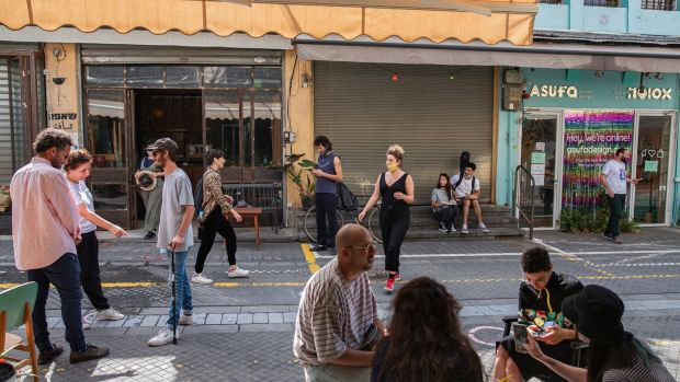 People venture outside in Tel Aviv on May 5th after Israel eased its coronavirus lockdown. It is now battling a resurgence of the virus. Photograph: Dan Balilty/New York Times