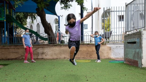 Children play in Tel Nordau school in Tel Aviv on May 5th, the day it reopened after a six-week coronavirus lockdown. Photograph: Guy Prives/Getty Images