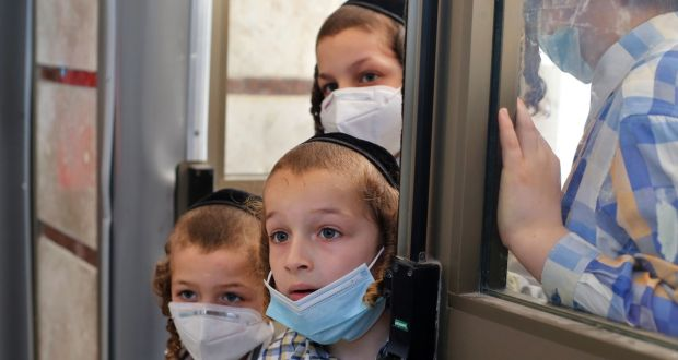 Children watch as medical workers take swab tests for Covid-19 at an ultra-Orthodox Jewish school in the central Israeli city of Rechovot, on June 25th. Photograph: Gil Cohen-Magen/AFP via Getty Images
